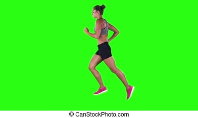 Woman running in sport clothing. Side view. Green screen....