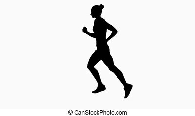 Woman jogging. Side view. Silhouette. Slow motion - Woman...