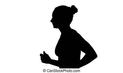 Girl with athletic body running. Side view. Silhouette....