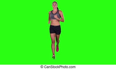 Woman running in a full body sideways shot. Green screen....