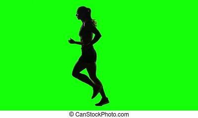 Running sport girl. Side view. Green screen. Silhouette -...