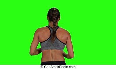 Woman jogging. Back view. Green screen. Slow motion