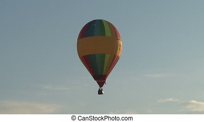 Balloon in the sky. - Colorful balloon flying in the blue...