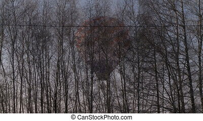 Balloon floating above the ground. - Balloon floating low...