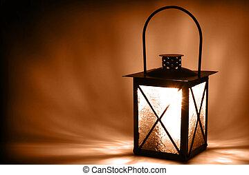 Light in the dark - Lit lantern on dark background, sepia...