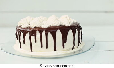 white cake covered with chocolate and cream - white cake...