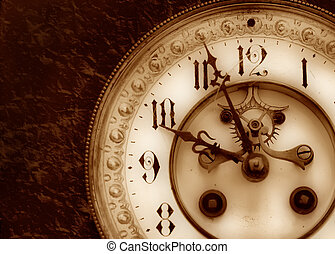 Vintage clock - Old clock on the relief background