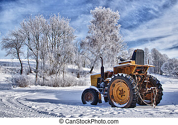 Winter sceneries in Lithuania, old tractor under the snow