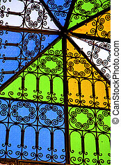 colorated glass and sun in morocco africa window and light