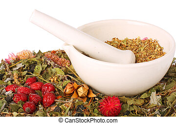 Mortar and pestle with herbs - mortar with dry herbs and...