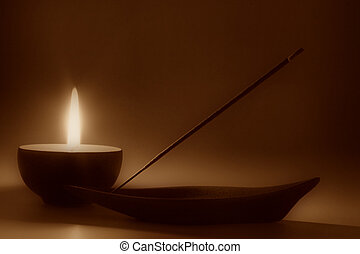 Meditation - candle and incense stick, sepia toned