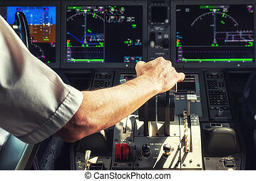 Operating the Throttle for Taking Off - Pilot Operating the...