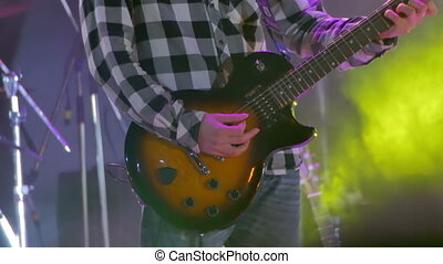 Guitarist Playing on the Stage at a Rock Concert - KAMENSKOE...