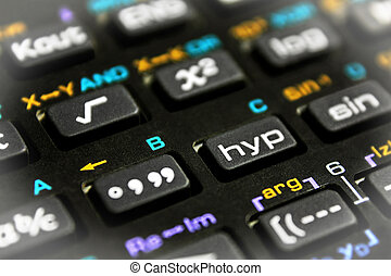 Scientific calculator buttons close up with bright vignette