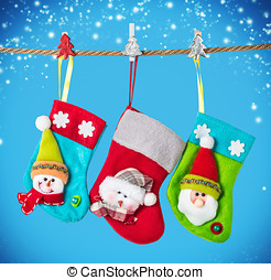 Christmas socks hanging on the background  a blue