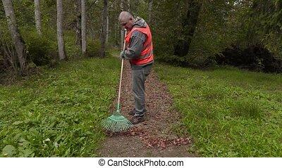 Man using rake on path