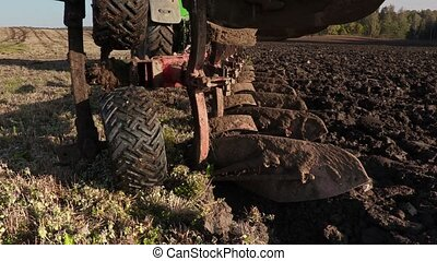 Tractor starts plowing field