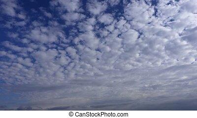 Clouds on blue sky.Timelapse
