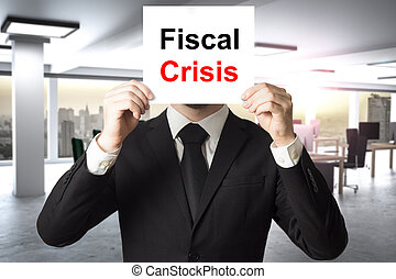 businessman hiding face behind sign fiscal crisis -...