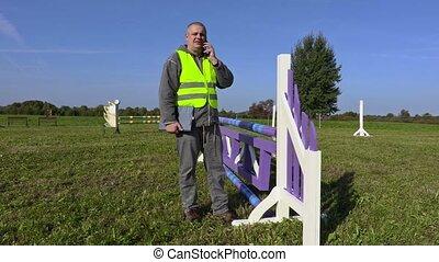 Man talking on phone and check hurdle
