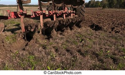 Tractor start plowing field on the