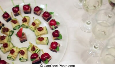 Sweet snacks are on the buffet table, the camera moves from one plate to another