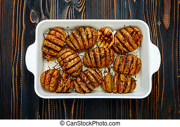 Baked spicy potatoes in baking dish