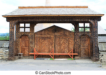 Traditional wooden gate from Maramures, Romania - A...