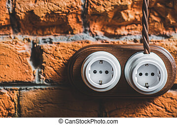 two new plastic sockets with wire on the old wall