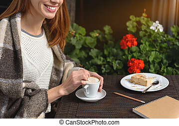 Cute girl resting in cafe outside - Happy young woman is...