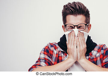 Attractive young man got a cold. All isolated on white...