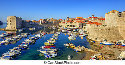 Old town port of Dubrovnik, Croatia - Colorful boats in the...