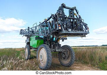 Self propelled sprayer in a Lithuanian field.