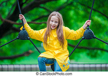 Happy little girl playng on outdoor playground - Little girl...