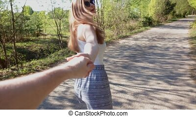 Beautiful girl is hand man of adventure. Follow me. Points of View.