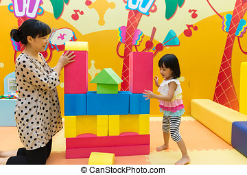 Asian Chinese Mom and Daugther Playing Giant Blocks At...