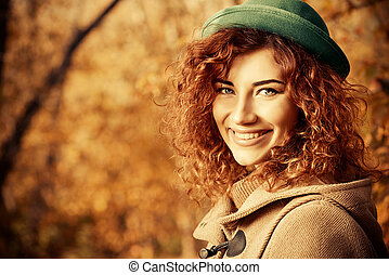 sincere happiness - Smiling red haired girl enjoys a sunny...