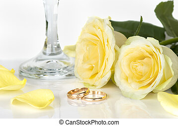 Wedding composition - wedding rings and twu yellow roses