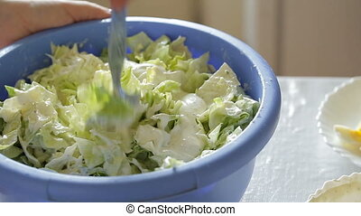 mixing a salad - close-up of mixing a salad