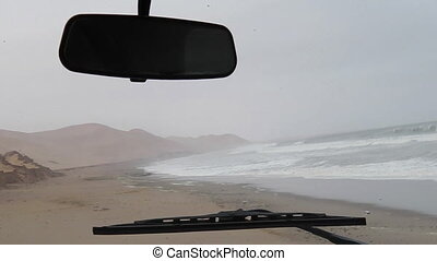 Sandwich Harbour drive - First person view on dunes of...