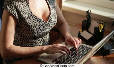 Busty sexy business woman working for a laptop. - Busty...