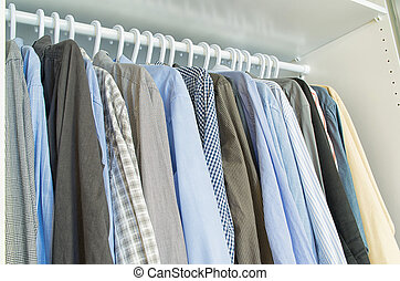 Men shirts hang on a clothes hanger