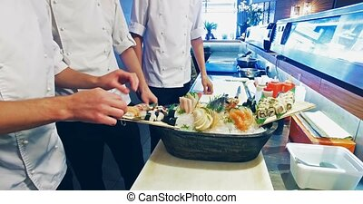 Decoration of sushi set. 4k, 25fps - 4k video shooting:...