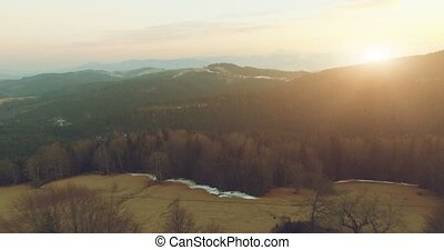 Mountain landscape at sunset. 4k, 25fps - Aerial Top View of...