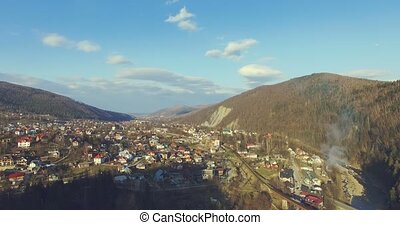 Carpathian cityscape and mountain river. 4k, 25fps - 4K...