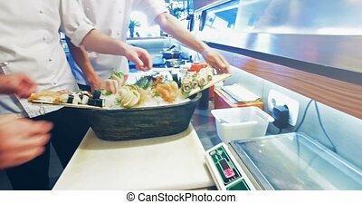 Decoration of sushi set. 4k, 25fps - 4k video shooting:...