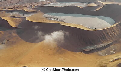 desert dunes flight in the Sossusvlei desert in the Namib...