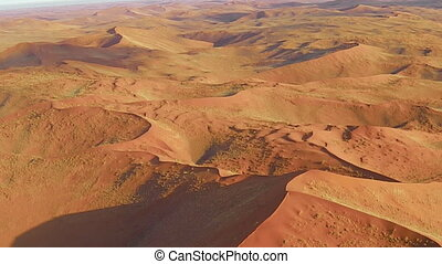 scenic flight dunes on the Sossusvlei desert in the Namib...