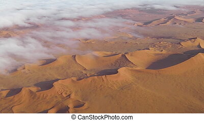 desert in clouds - clouds on desert dune in the Namib...