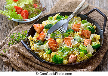 Italian pasta with salmon - Italian pasta with fried cuts of...